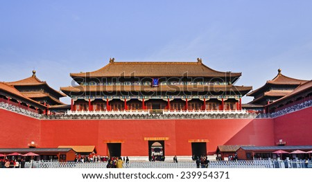 China Beijing Forbidden city main entry palace and gate with entry points and people crowds going through red defensive walls to ancient empire landmark - stock photo