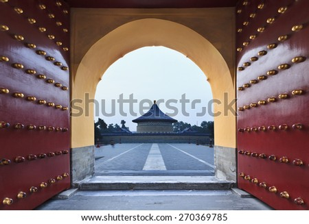 China, Beijing' Garden of Heaven - residency of ancient chinese emperors. Red-gold imperial gates wide open towards round temple - stock photo