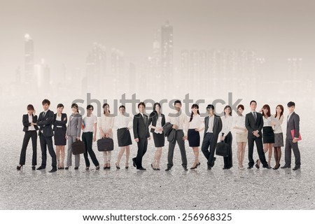 China business team of young people stand on white studio background.