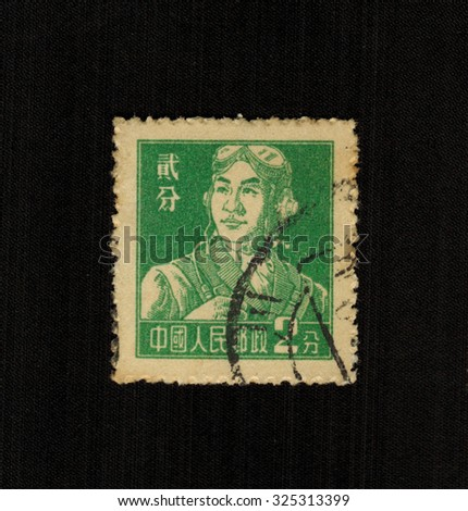CHINA - CIRCA 1958: A stamp printed in China shows a drawing of a young pilot, circa 1958 - stock photo