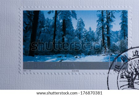 CHINA - CIRCA 2004:A stamp printed in China shows image of China 2004-24 Frontier Scenes of China Stamps Landscape Forest of Xing an mounatins,circa 2004 - stock photo