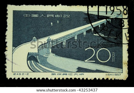 CHINA - CIRCA 1957: A stamp printed in China shows Wuhan - Bridge over Yangtze River, circa 1957.