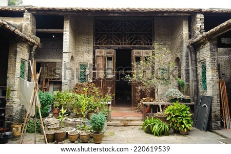 China Guangzhou - July 8, 2013: Aged Traditional home building in countryside of Guangzhou in China. Interior of Ancient village house in GuangDong, GuangZhou, China - stock photo