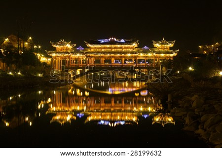 china/guizhou: night view of ancient wind-rain bridge in Xijiang Hmong village