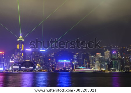 China, Hong Kong - October 2013: A Symphony of Lights show on the skyline - stock photo