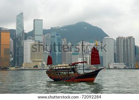 China, junk in Hong Kong harbor - stock photo
