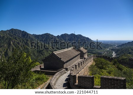 CHINA, JUYONGGUAN - SEP 8, 2014: Photo of the tower with the construction of the Great Wall