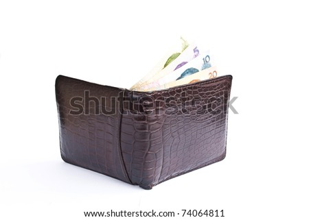 China money in crocodile short wallet.