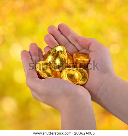 China's gold ingot in the hands of children   - stock photo
