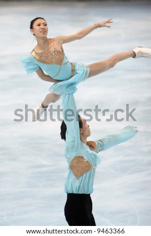 China's Quing Pang and Jian Tong perform during the pairs free program event. This is pair's free program as of season 2007/2008 - stock photo
