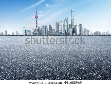 China's Shanghai city buildings and asphalt road - stock photo