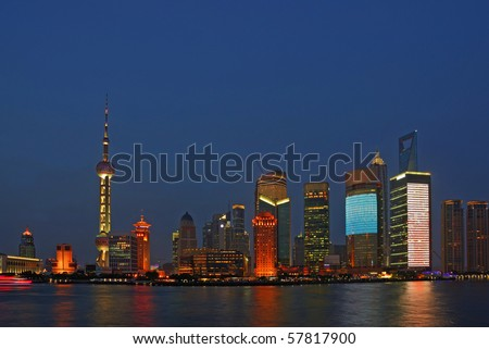 China Shanghai Huangpu river and Pudong buildings  night view. - stock photo