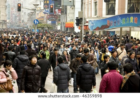 CHINA, SHANGHAI - JANUARY 22: crowded city center just before Chinese New Year on January 22, 2010 in Shanghai, China.