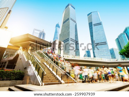 China Shanghai Lujiazui financial district, the streets of escalators and the crowd. - stock photo