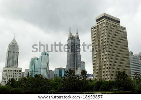 China, Shanghai. Modern skyscrapers, office buildings and hotels surrounding People's Square in city center.