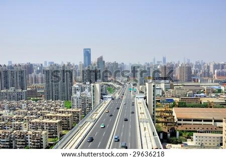 China Shanghai Puxi skyline from the Lupu bridge. - stock photo