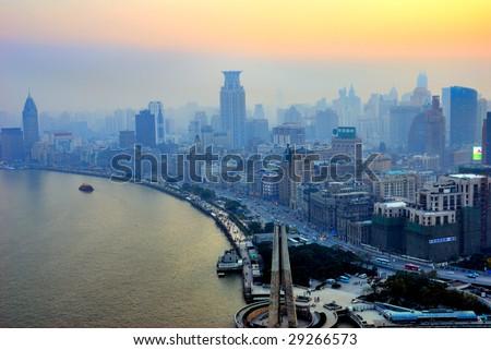 China Shanghai  the Bund and Puxi skyline at sunset. - stock photo