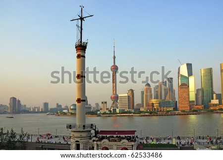 China Shanghai the Meteorological Signal Tower and Pudong skyline at sunset. - stock photo