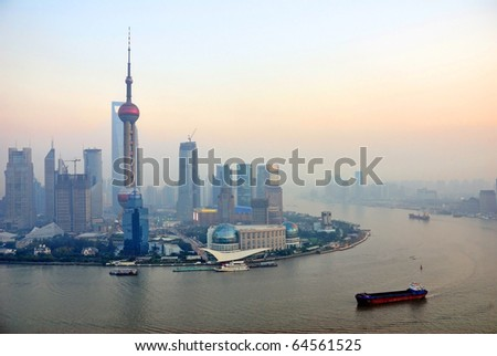 China Shanghai the pearl tower and Pudong skyline at sunset. - stock photo