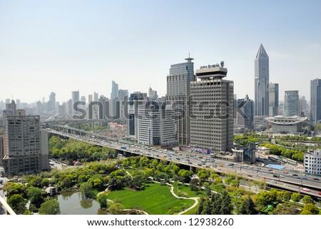 China Shanghai yan an road and city skyline - stock photo