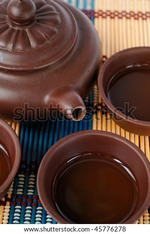 china tea ceremony in ceramic set closeup - stock photo