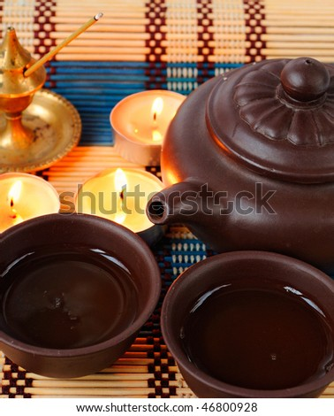 china tea ceremony with candles and aromatic stick - stock photo