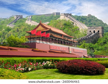 China Tiananmen gate with Great Wall in background. Chinese text on the red wall reads: Long live China and the unity of all peoples in the world. - stock photo