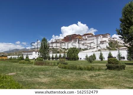 China Tibet grassland and the Potala Palace. - stock photo