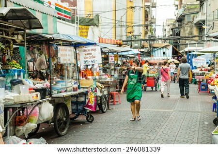 CHINA TOWN,BANGKOK, THAILAND - JULY 12: Street Food on China Town Yaowarat road. Popular tourist eating food,dessert,fruit and snack. This road is main Economic road in bangkok