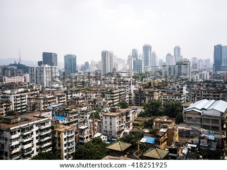 China urban cityscape. Guangzhou, Guangdong province. Skyscrapers and slums. - stock photo