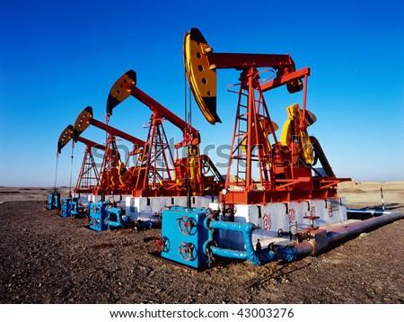 China/xinjiang: oil pumping units in kelamay city - stock photo