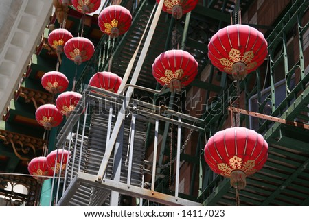 CHINATOWN CHINESE LANTERN Red and gold Chinese lanterns hanging from a building in San Francisco Chinatown - stock photo