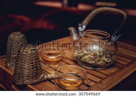 Chinees tea ceremony with glass teapot and cups. - stock photo