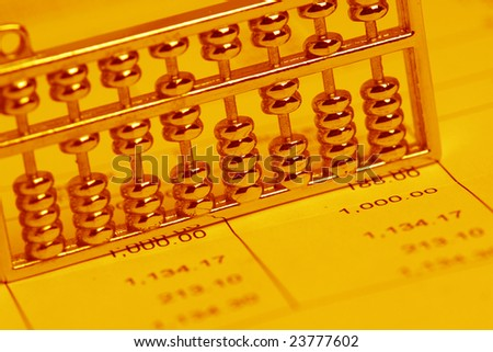 chinese abacus and bill - stock photo