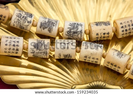 Chinese ancient prayers necklace - stock photo