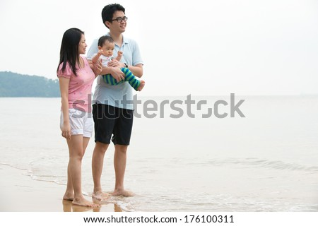 chinese asian Family walking On the Beach