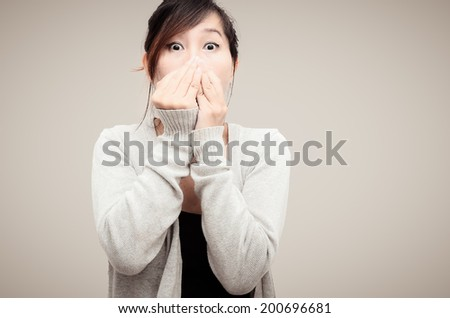 Chinese Asian woman Model wearing grey cardigan isolated.