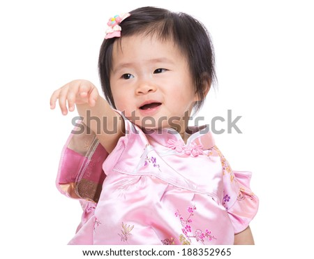 Chinese babby girl hand up and point to front - stock photo
