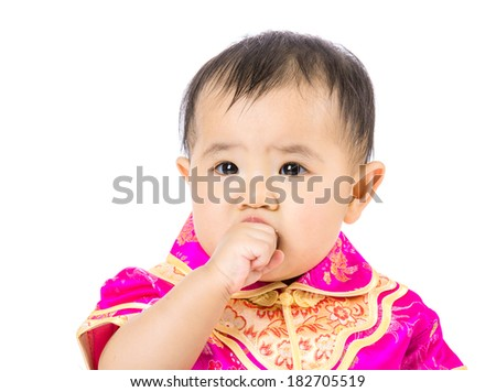 Chinese baby girl suck finger into mouth