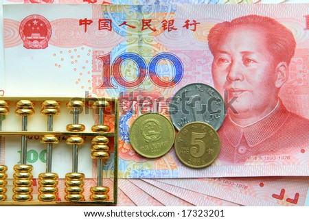 chinese bank note, coins and abacus - stock photo