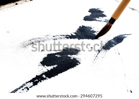 Chinese brushes draw on white papers - stock photo