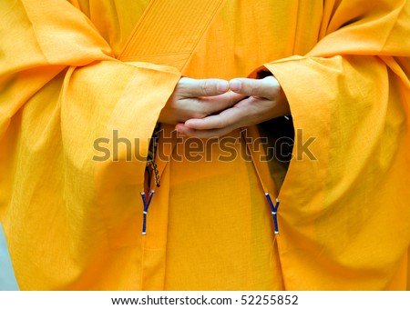 Chinese buddhist monk hand and fingers detail, the monk in praying. - stock photo