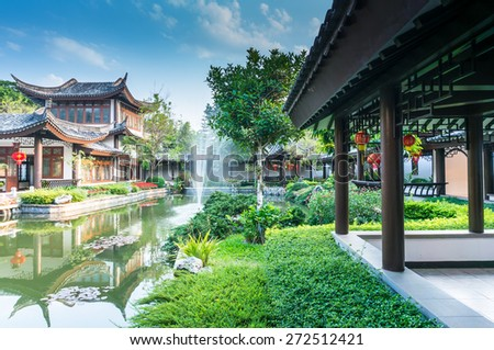 Chinese building and fountain pond - stock photo