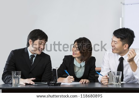 Chinese Business people discussing ideas in a meeting. - stock photo