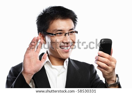 Chinese businessman happy expression when using video call, isolated on white background - stock photo