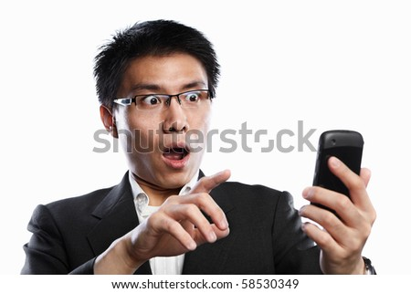 Chinese businessman surprised expression when using video call, isolated on white background - stock photo