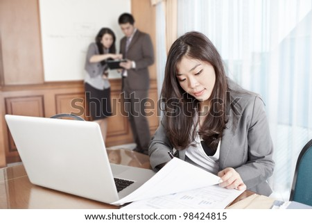 Chinese businesswoman working seriously in the office