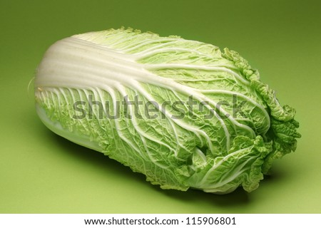 Chinese cabbage isolated on a green background. - stock photo
