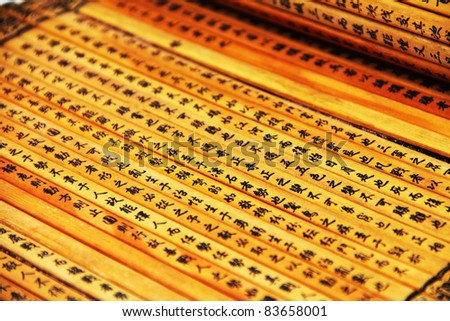 Chinese characters on a bamboo scroll - stock photo