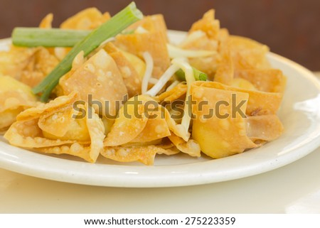 Chinese cheese wontons appetizer at restaurant served with green onion and bean sprouts - stock photo